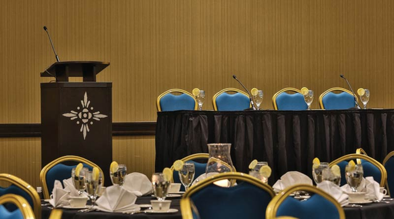 view of tables and a podium set up for an event at the Keystone Grand Ballroom